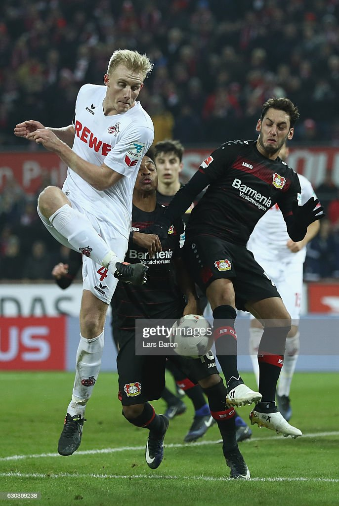 Frederik Soerensen of Koeln is challenged by Wendell of Bayer Leverkusen and Hakan Calhanoglu of Bayer Leverkusen during the Bundesliga match between 1. FC Koeln and Bayer 04 Leverkusen at RheinEnergieStadion on December 21, 2016 in Cologne, Germany.
