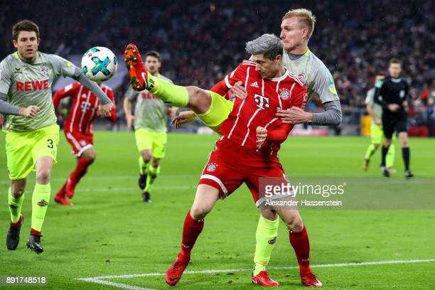 Frederik Sorensen of 1FC Koeln and Robert Lewandowski of Bayern Munich battle for the ball the Bundesliga match between FC Bayern Muenchen and 1 FC...