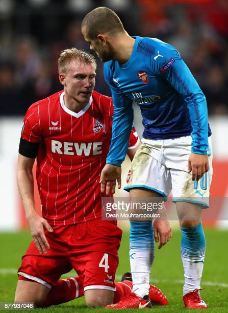 Frederik Sorensen of FC Koeln and Jack Wilshere of Arsenal speak after a collision during the UEFA Europa League group H match between 1 FC Koeln and...