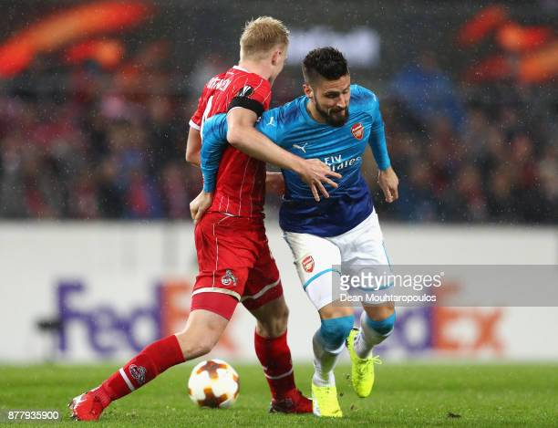 Frederik Sorensen of FC Koeln and Olivier Giroud of Arsenal in action during the UEFA Europa League group H match between 1 FC Koeln and Arsenal FC...