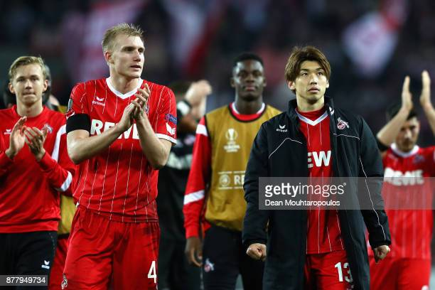 Frederik Sorensen of FC Koeln and Yuya Osako of FC Koeln shows appreciation to the fans after the UEFA Europa League group H match between 1 FC Koeln...