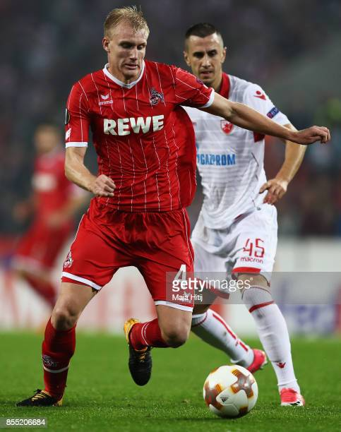 Frederik Sorensen of FC Koeln battles for the ball with Aleksandar Pesic of Crvena zvezda during the UEFA Europa League group H match between 1 FC...