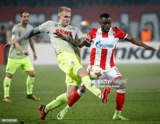 Frederik Sorensen of FC Koeln competes for he ball against Guelor Kanga of Crvena Zvezda during the UEFA Europa League group H match between Crvena...