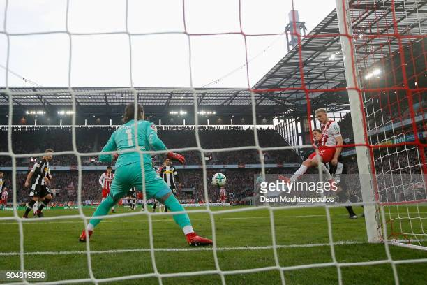 Frederik Sorensen of FC Koeln shoots and scores a goal past Goalkeeper Yann Sommer of Borussia Monchengladbach during the Bundesliga match between 1...