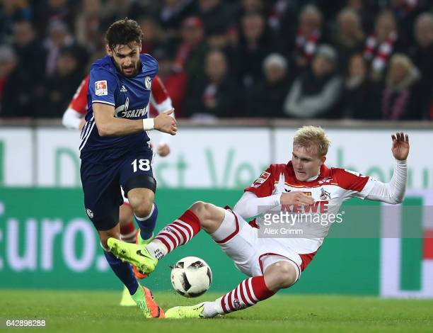 Frederik Sorensen of Koeln challenges Daniel Caligiuri of Schalke during the Bundesliga match between 1 FC Koeln and FC Schalke 04 at...