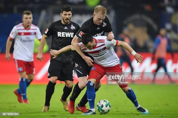 Frederik Sorensen of Koeln fights for the ball with Filip Kostic of Hamburg during the Bundesliga match between Hamburger SV and 1 FC Koeln at...
