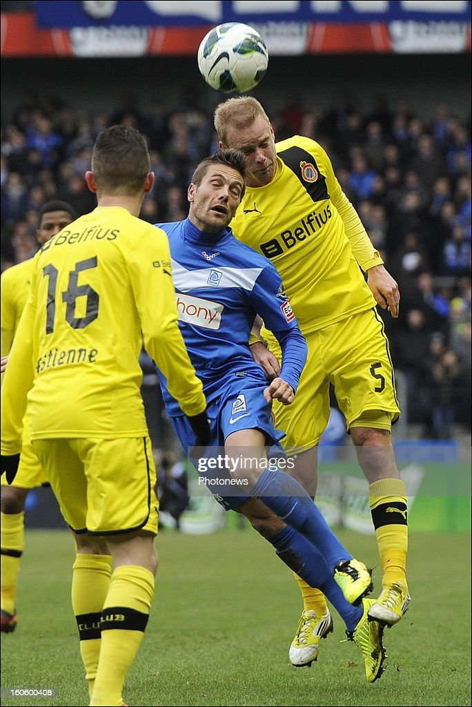 Frederik Stenman of Club Brugge KV battles for the ball with Benji De Ceulaer of KRC Genk during the Jupiler League match between KRC Genk and Club Brugge KV on February 3, 2013 in Genk, Belgium.