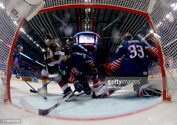 Frederik Tiffels of Germany challenges Evan Mosey of Great Britain during the 2019 IIHF Ice Hockey World Championship Slovakia group A game between...