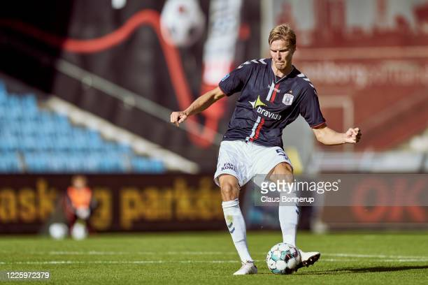 Frederik Tingager of AGF Aarhus controls the ball during the Danish 3F Superliga match between AaB Aalborg and AGF Aarhus at Aalborg Portland Park on...