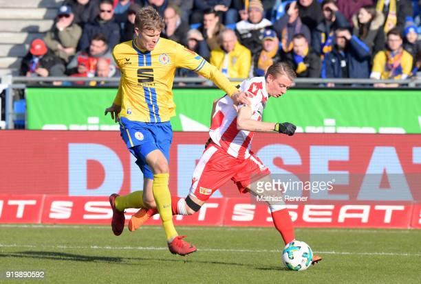 Frederik Tingager of Eintracht Braunschweig and Simon Hedlund of 1 FC Union Berlin during the second Bundesliga match between Eintracht Braunschweig...