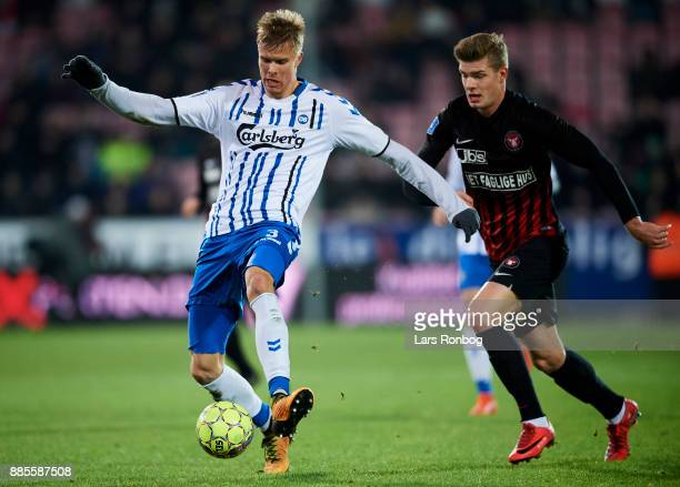 Frederik Tingager of OB Odense and Alexander Sorloth of FC Midtjylland compete for the ball during the Danish Alka Superliga match between FC...