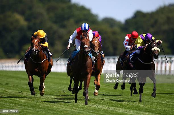 Frederik Tylicki rides Double Up to win The Totescoop6 Heritage Handicap stakes at Ascot racecourse on July 11 2015 in Ascot England