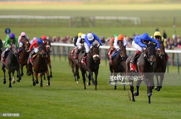 Frederik Tylicki riding Albasharah win The Betfred Mobile Pride Stakes at Newmarket racecourse on October 11 2014 in Newmarket England