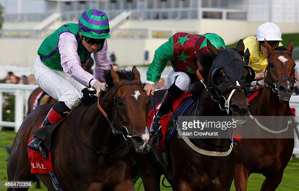Frederik Tylicki riding Arthenus win The Champagne Bollinger Classified Stakes at Ascot racecourse on September 04 2015 in Ascot England