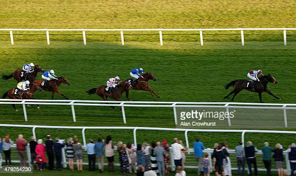 Frederik Tylicki riding Pretty Bubbles win The Weatherbys EBF Stallions Breeding Winners Fillies' Stakes at Newbury racecourse on July 02 2015 in...