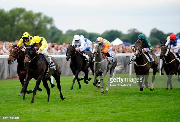 Frederik Tylicki riding Rekdhat win The Betdaq 3% Commission Fillies' Handicap Stakes at Windsor racecourse on July 14 2014 in Windsor England