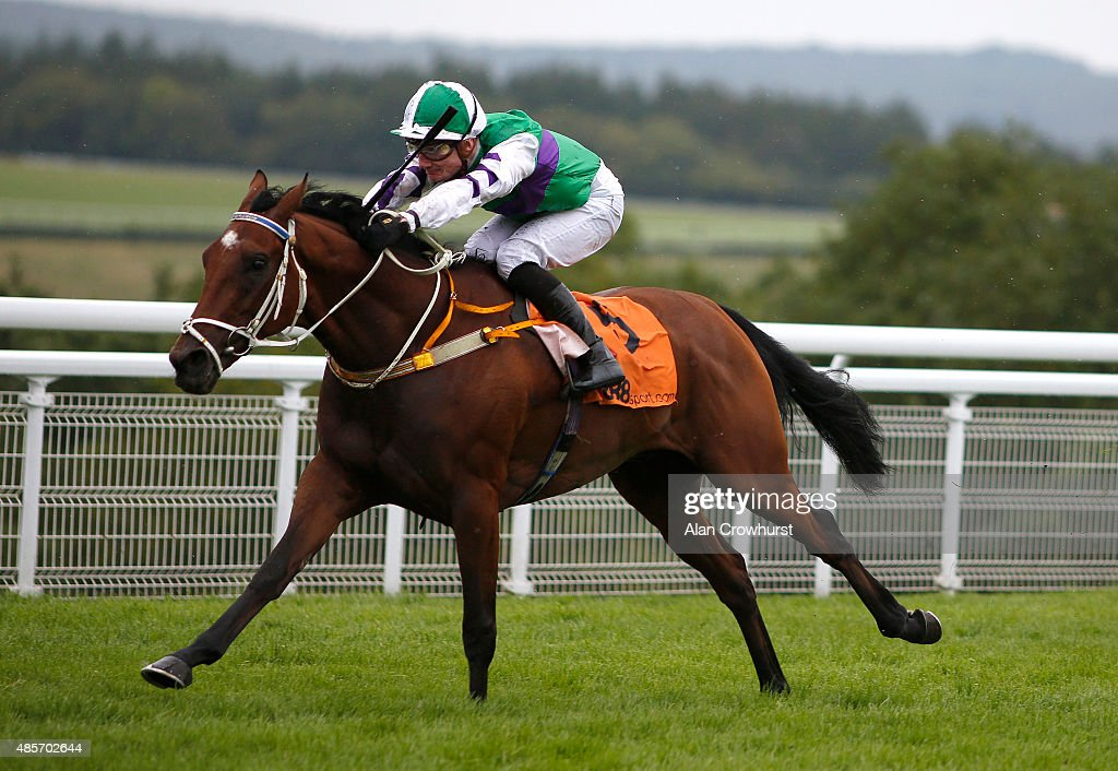Frederik Tylicki riding The Twisler win The 888sport March Stakes at Goodwood racecourse on August 29, 2015 in Chichester, England.