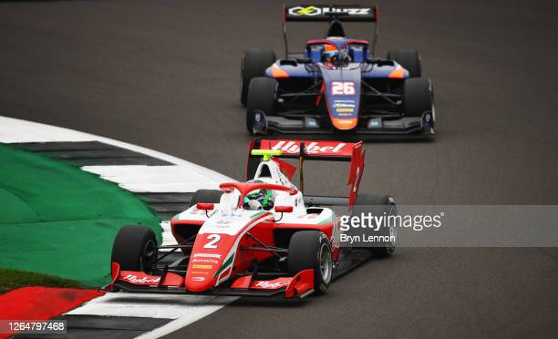 Frederik Vesti of Denmark and Prema Racing leads Clement Novalak of Great Britain and Carlin Buzz Racing during race two of the Formula 3...