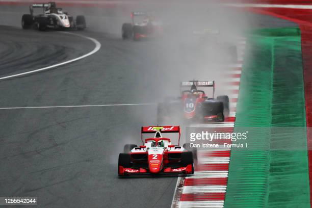 Frederik Vesti of Denmark and Prema Racing leads Lirim Zendeli of Germany and Trident during the feature race for the Formula 3 Championship at Red...