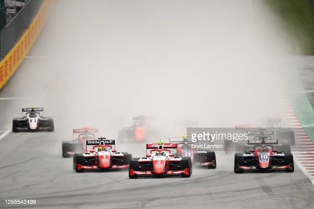 Frederik Vesti of Denmark and Prema Racing leads Lirim Zendeli of Germany and Trident into the first corner at the start of the race during the...