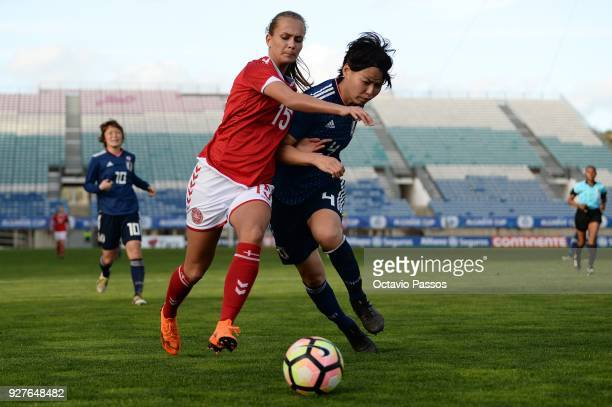 Frederikke Thogersen of Denmark competes for the ball with Saki Kumagai of Japan during the Women's Algarve Cup Tournament match between Denmark and...