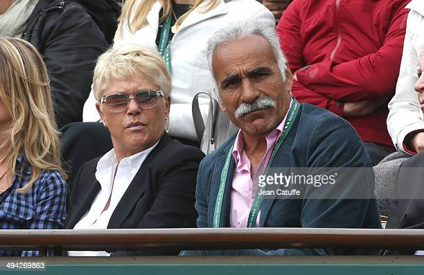 Frederique Bahrami and husband Mansour Bahrami attend Day 3 of the French Open 2014 held at RolandGarros stadium on May 27 2014 in Paris France