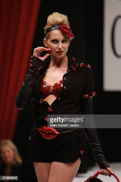 Frederique Bel displays a chocolate decorated dress during the Chocolate dress fashion show celebrating Salon Du Chocolat 15th Anniversary Opening...