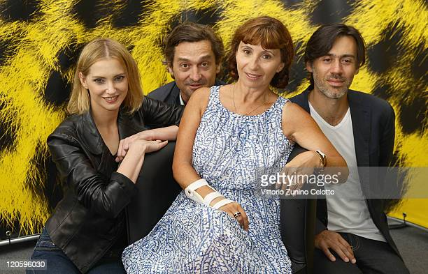 Frederique Bel Frederic Niedermayer Ariane Ascaride Emmanuel Mouret attends 'L'Art d'Aimer' photocall during the 64th Festival del Film di Locarno on...