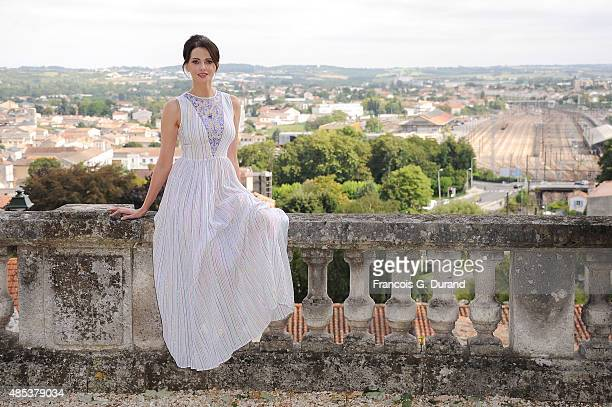 Frederique Bel poses at a photocall for the film 'L'etudiante et Monsieur Henri' during the 8th Angouleme FrenchSpeaking Film Festival on August 27...