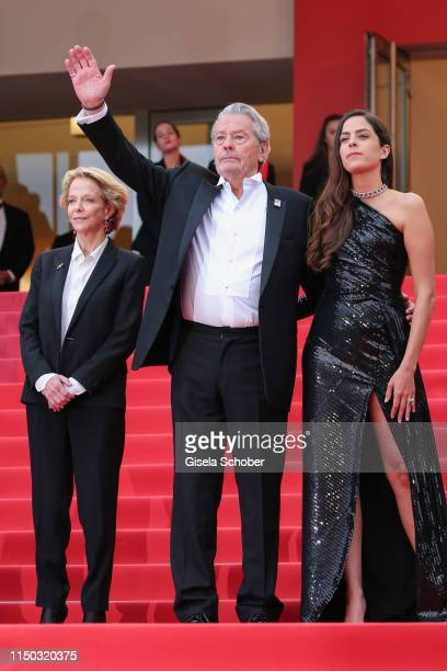 Frederique Bredin Alain Delon and Anouchka Delon attend the screening of A Hidden Life during the 72nd annual Cannes Film Festival on May 19 2019 in...