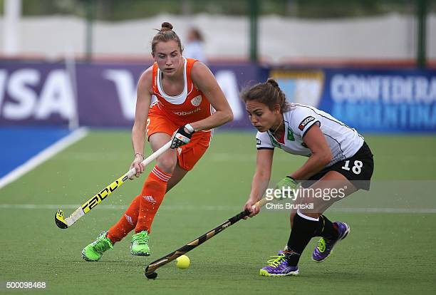 Frederique Derkx of the Netherlands takes on Lisa Altenburg of Germany during the Hockey World League Final Pool A match between the Netherlands and...