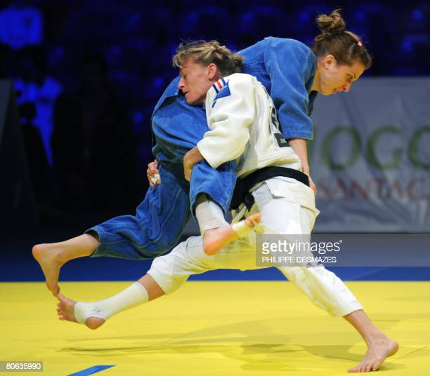 Frederique Jossinet of France fights with Alina Dumitru of Romania in the women's under 48 kg final of the Euro Judo Championship in Lisbon on 11...