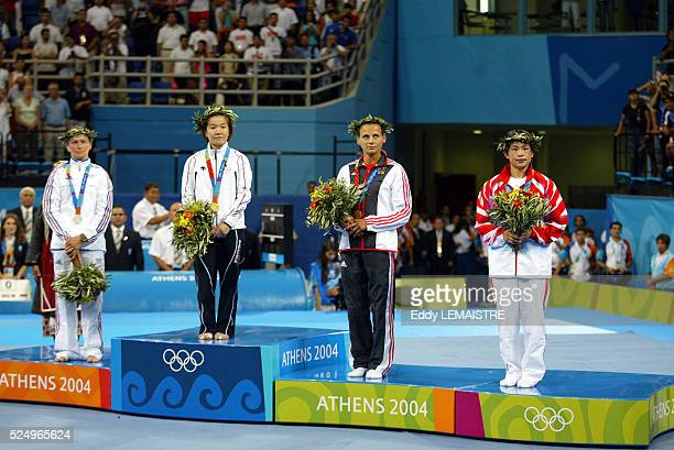 Frederique Jossinet silver medalist Ryoko Tani gold medalist Julia Matijass and Feng Gao bronze medalists show off thier medals for the women's under...