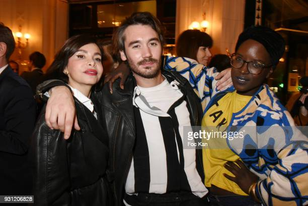 Frederique Lopez Benjamin Belin and Fate Damn attend Marc Cerrone Exhibition Preview at Deux Magots a on March 12 2018 in Paris France