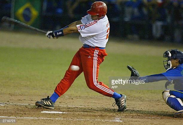 Fredery Cepeda de la seleccion de Cuba trata de batear cuando se enfrenta a la seleccion de Brasil el 08 de noviembre de 2003 durante el torneo...