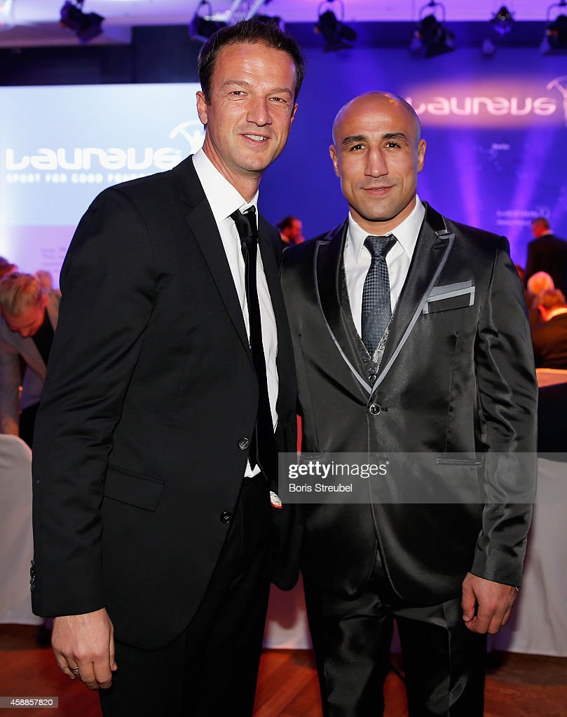 Fredi Bobic (L) and Arthur Abraham pose prior to the Laureus Media Award 2014 at Grand Hyatt Hotel on November 12, 2014 in Berlin, Germany.