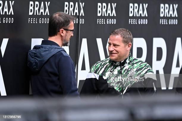 Fredi Bobic, Director of Sport at Eintracht Frankfurt speaks to Max Eberl, Director of Sports at Borussia Mönchengladbach prior to the Bundesliga...