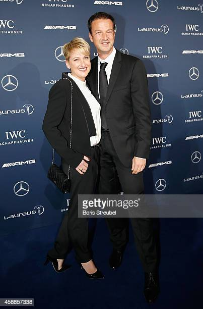 Fredi Bobic former football player and his wife Britta Bobic pose prior to the Laureus Media Award 2014 at Grand Hyatt Hotel on November 12 2014 in...