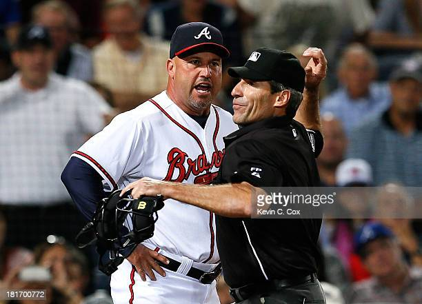 Fredi Gonzalez of the Atlanta Braves is ejected in the seventh inning by homeplate umpire Angel Hernandez during the game against the Milwaukee...