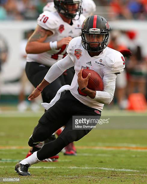Fredi Knighten of the Arkansas State Red Wolves rushes during a game against the Miami Hurricanes at Sunlife Stadium on September 13 2014 in Miami...
