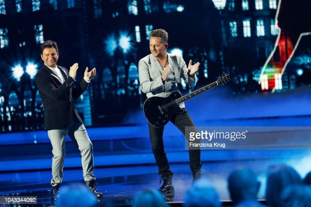 Fredi Malinowski and Martin Marcell of 'Fantasy' perform during the television show 'Willkommen bei Carmen Nebel' at Velodrom on September 29 2018 in...