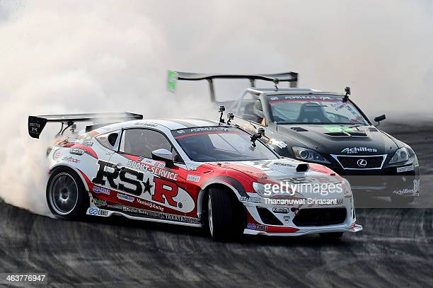 Fredric Aasbo of Norway drives 2012 ZN6 Toyota 86 ahead of Daigo Saito of Japan driving the Achilles Radial Lexus ISC during Formula Drift Asia on...