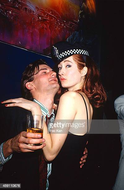 Fredric Beigbeder and a model attend a fashion week Party at Les Bains Douches in the 1990s in Paris France