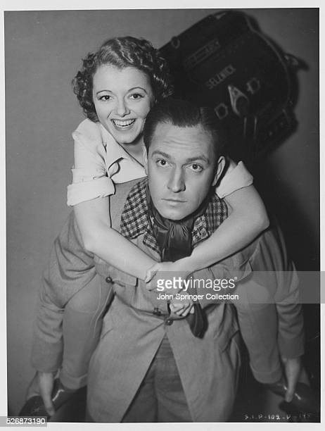 Fredric March gives Janet Gaynor a piggyback ride on the set of A Star is Born