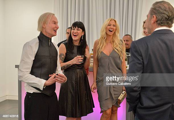 Fredric S Brandt poses with guests at the viewing of Fredric S Brandt's Art Collection cocktail party on December 4 2012 in Coconut Grove Florida