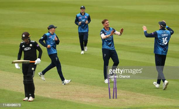 Fredrick Klaassen of Kent celebrates bowling Conor McKerr of Surrey with Zak Crawley of Kent during the Royal London One Day Cup match between Surrey...