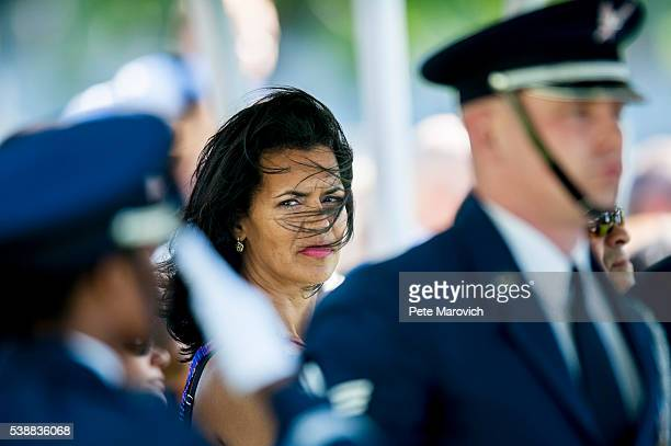 Fredricka Whitfield looks on as the Air Force Band plays at the gravesite service of her father fivetime Olympian gold medalist and Tuskegee Airman...