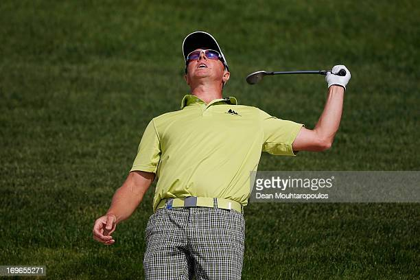 Fredrik Andersson Hed of Sweden reacts after he hits his second shot on the 2nd hole during Day One of the Nordea Scandinavian Masters at Bro Hof...