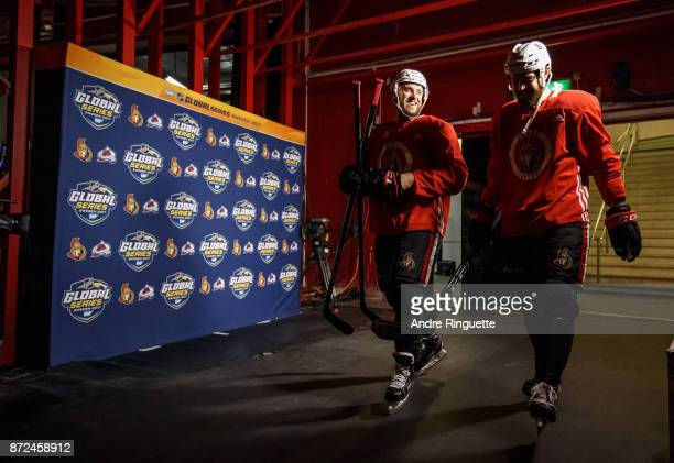Fredrik Claesson and Zack Smith of the Ottawa Senators walk to the ice surface for practice at Ericsson Globe on November 10 2017 in Stockholm Sweden