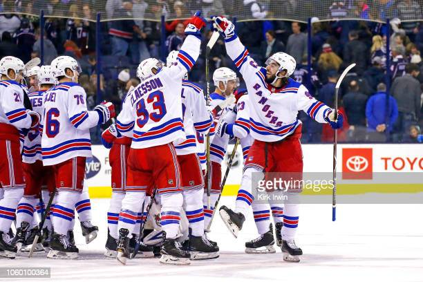 Fredrik Claesson of the New York Rangers and Mika Zibanejad celebrate after defeating the Columbus Blue Jackets 54 in a shootout on November 10 2018...